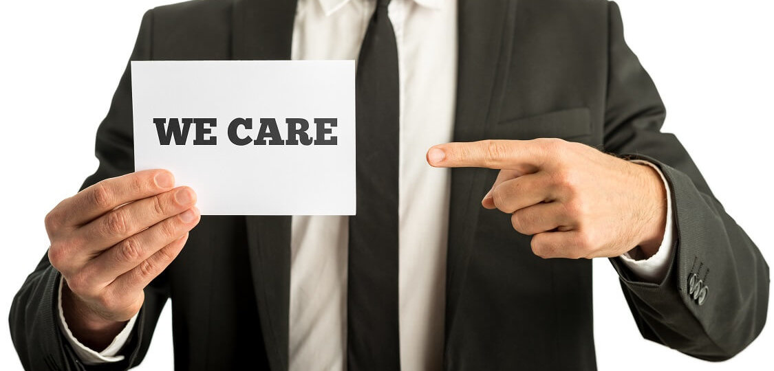 Businessman with a sign - We Care