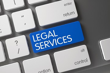 Legal Services Concept Laptop Keyboard with Legal Services on Blue Enter Key Background, Selected Focus. 3D.